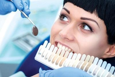 lady getting teeth whitened | madera ca dentist