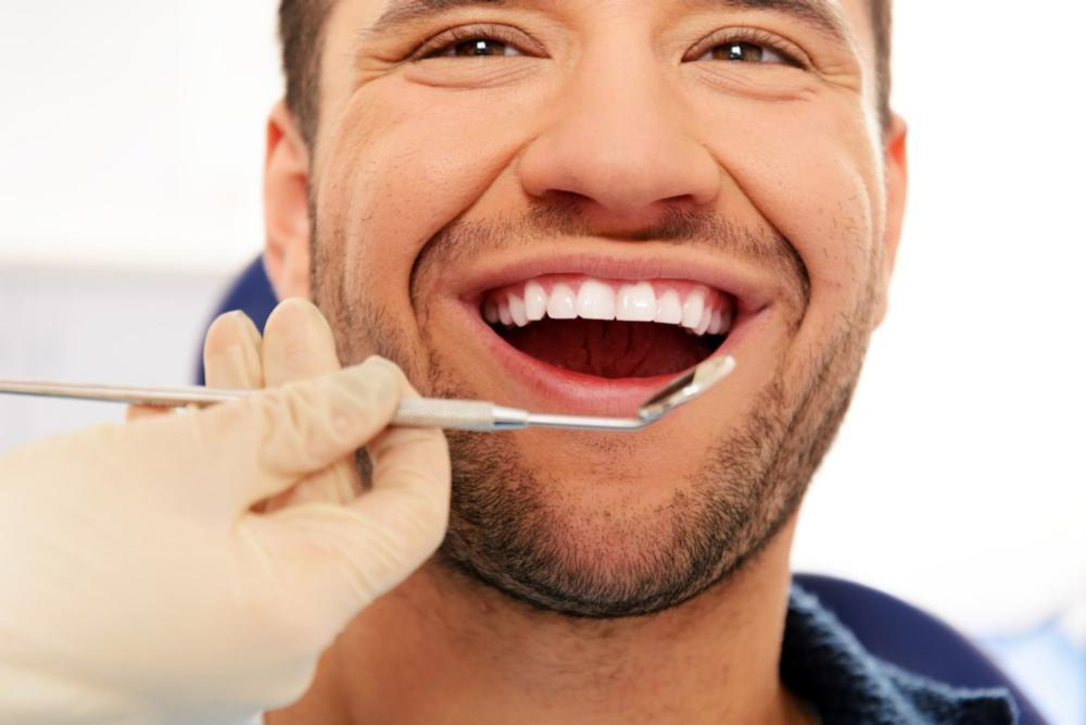 Happy Male at Dentist | General Dentistry