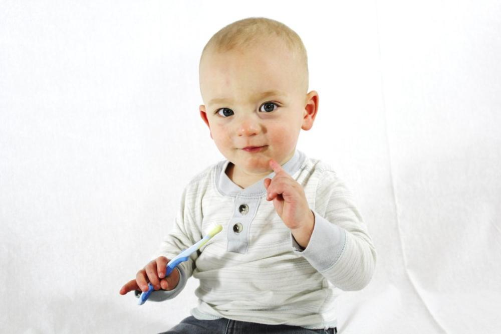 Baby with toothbrush | Pediatric Dentistry Madera, CA