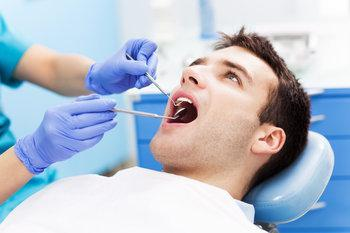 man getting a tooth extraction in madera ca
