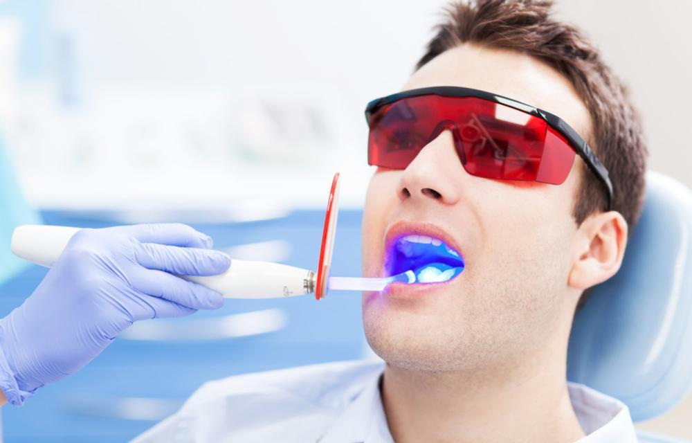 man getting a root canal in Madera CA