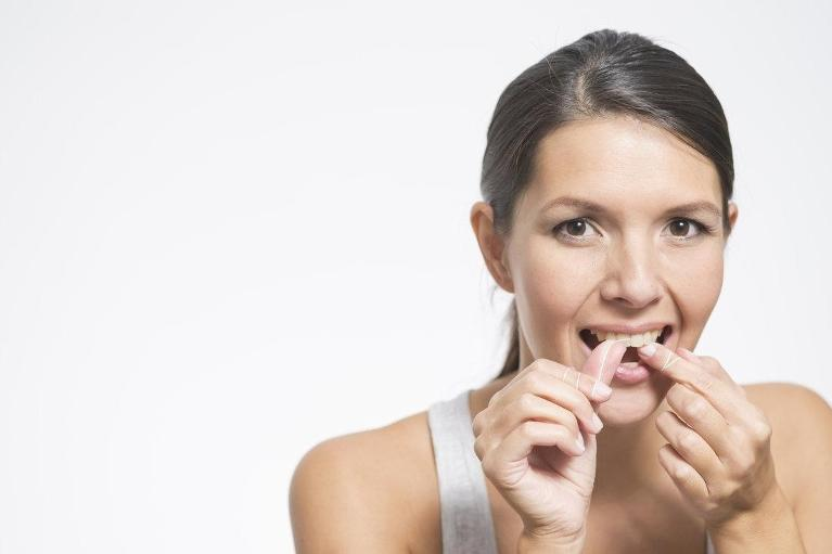 Patient Flossing Teeth | Madera CA Preventative Dentist