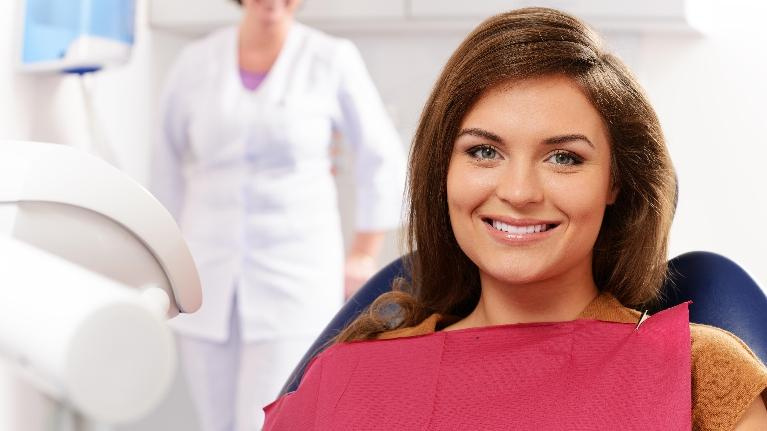 A Woman Smiles In The Dental Chair | Family Dentist Madera CA