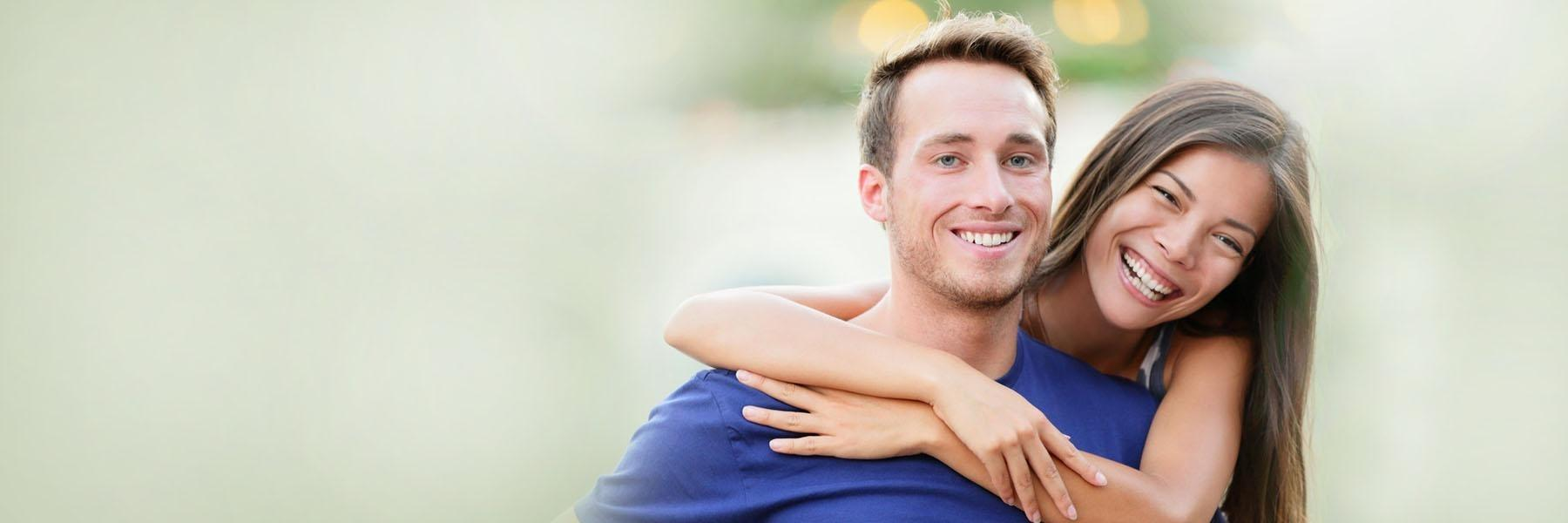 younger couple smiling together | madera ca dentist
