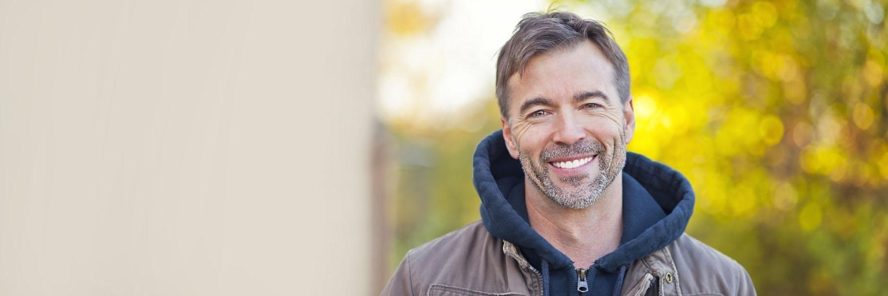 middle aged man smiling | dental implants madera ca